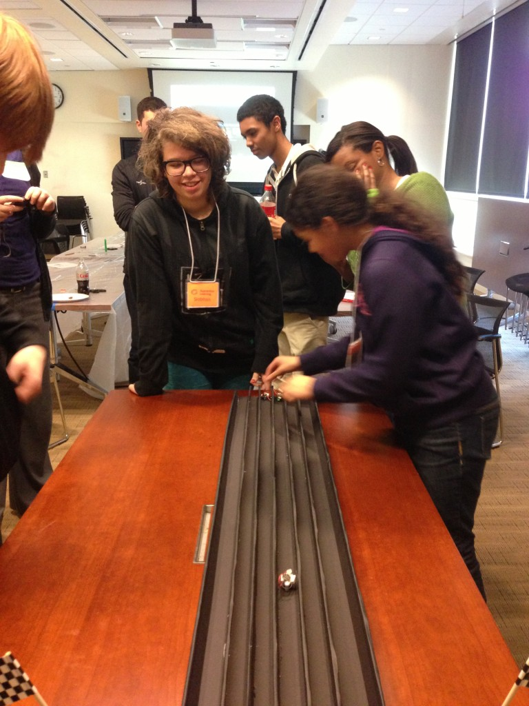 Siobhan and Kaya test their mini robots at the Wyss Institute during Apprentice Learning.